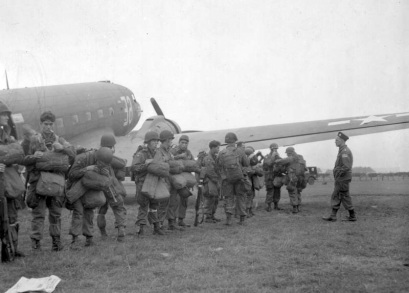 Paratroopers of the 82nd Airborne Division assemble next to the transport planes that will be taking them to Holland. Date is 17 September 1944. (National Archives)